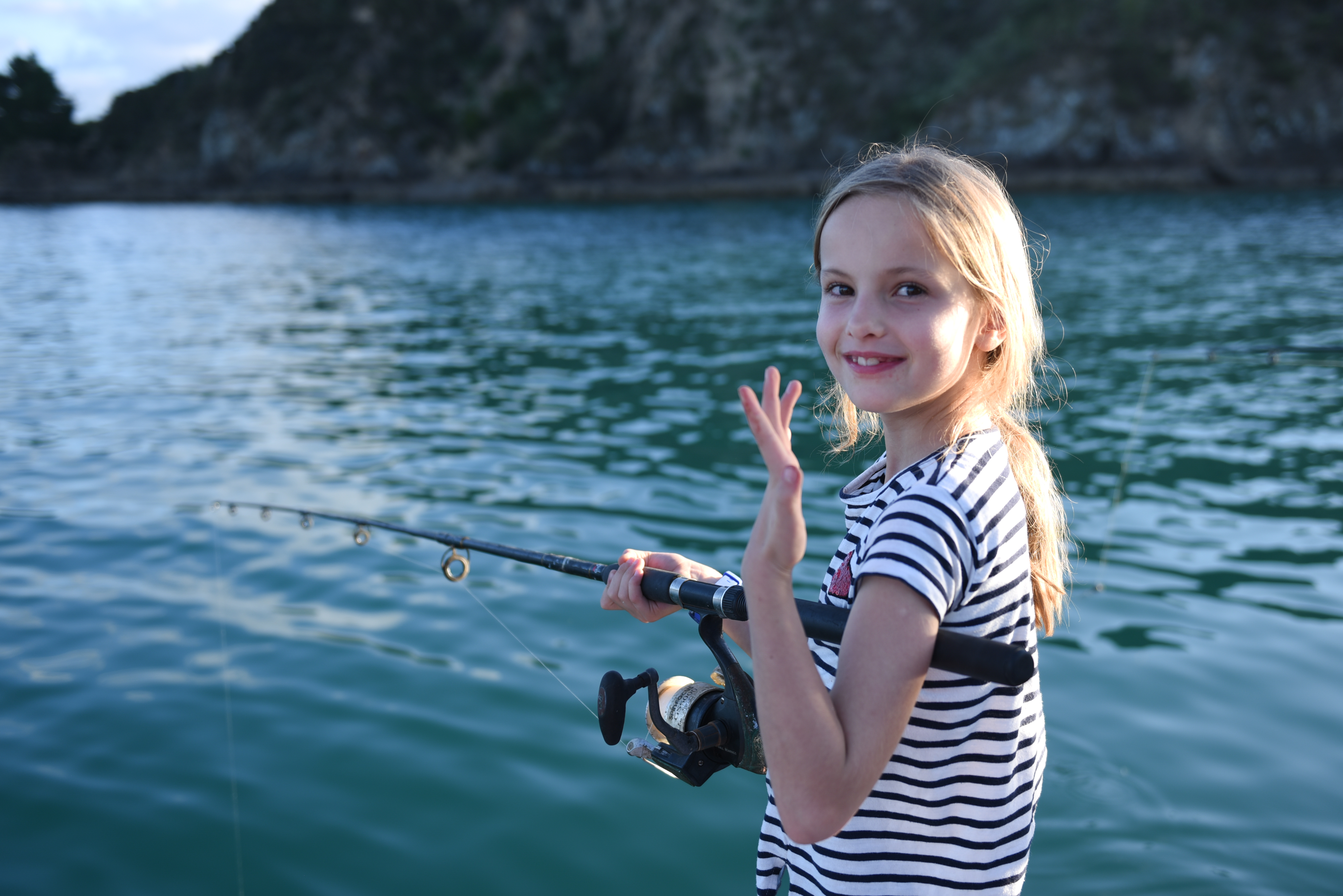 little girl dusk fishing aboard The Rock Adventure Cruise