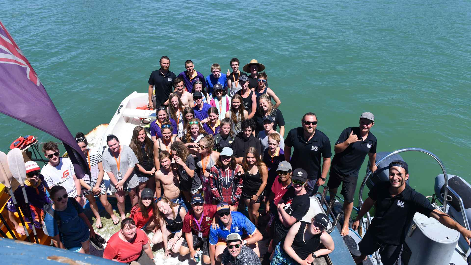 big group pic back of boat the rock