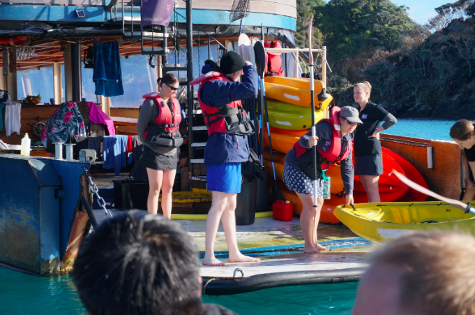 Guests at The Rock NZ getting the paddle boats