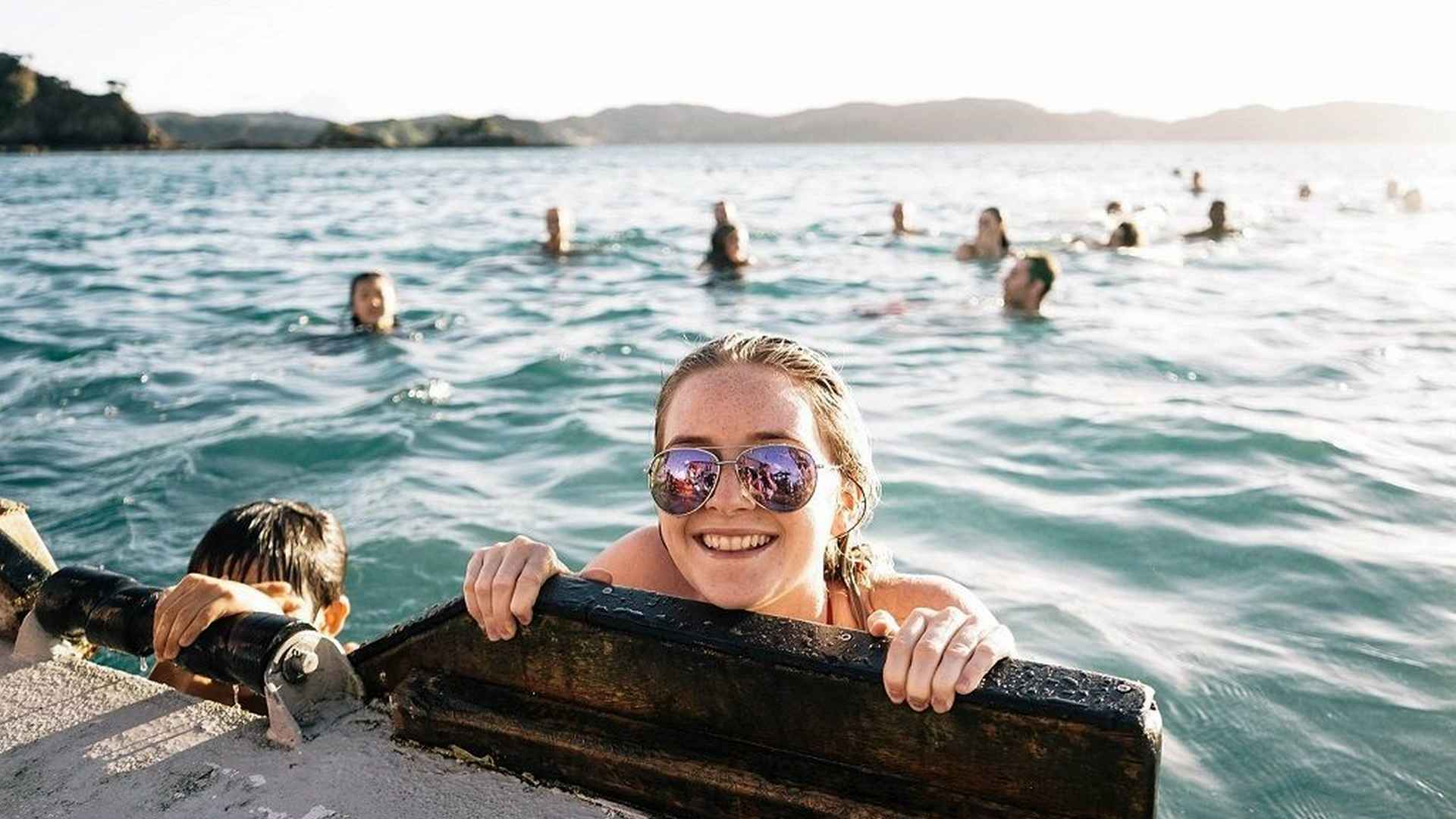 Enjoy a dip in the crystal clear waters of the Bay of Islands aboard The Rock