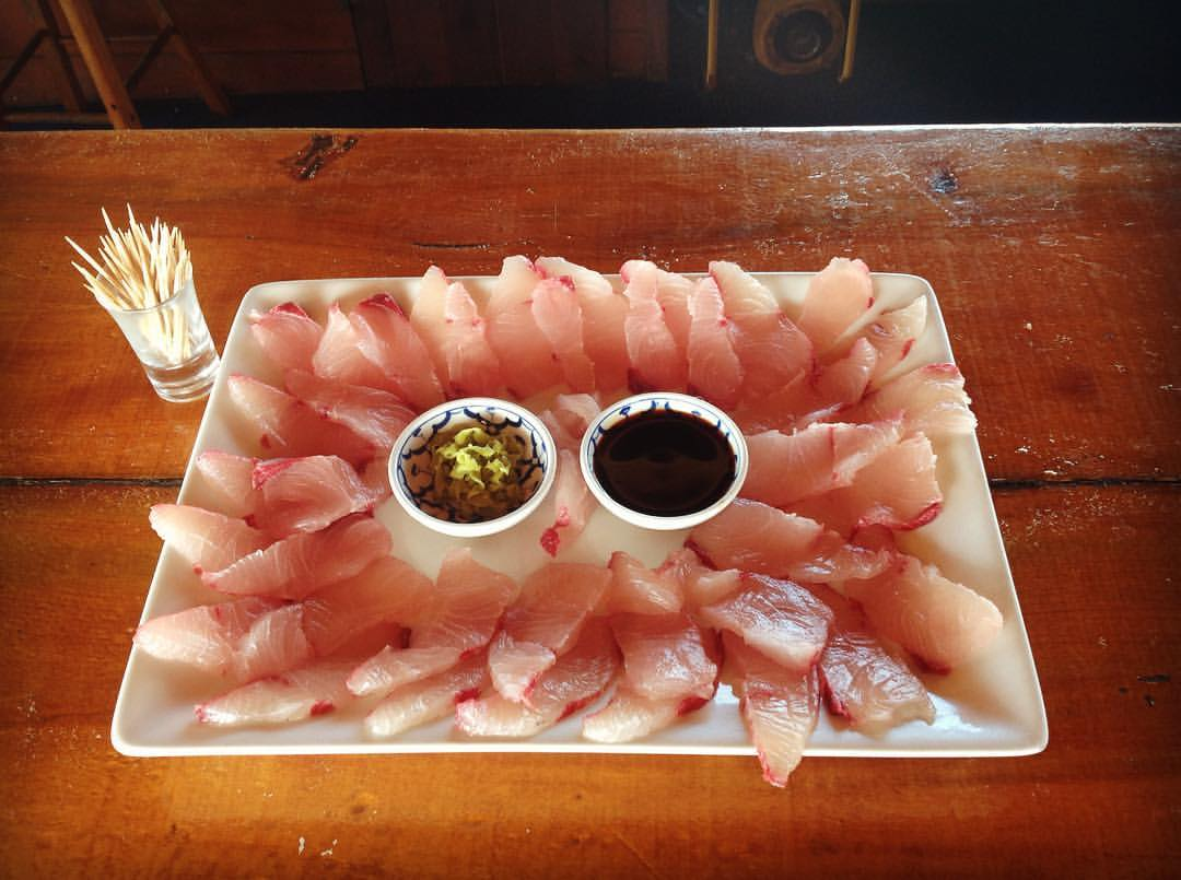 Fresh kingfish sashimi served at The Rock