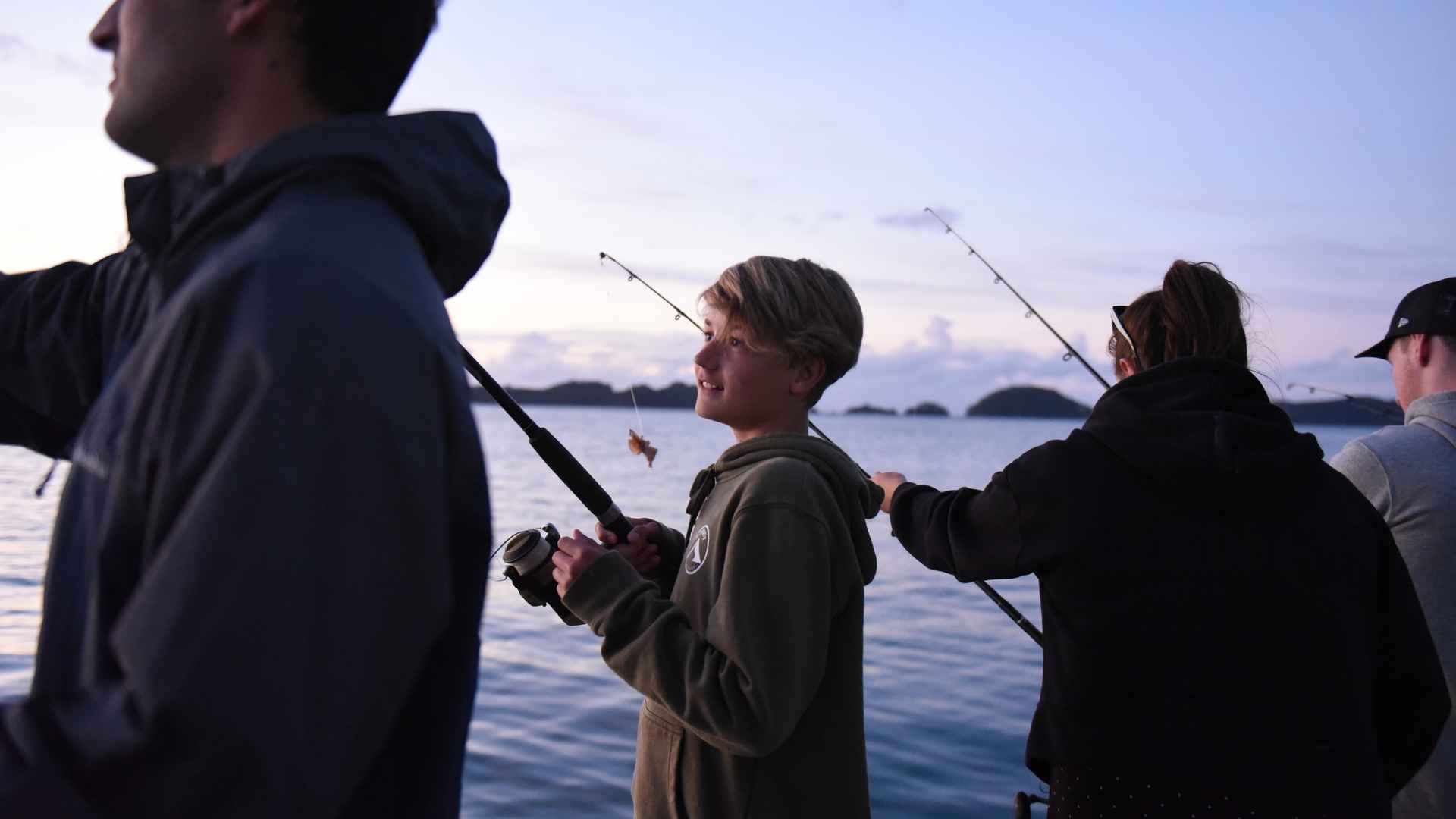 kid fishing at the rock bay of islands