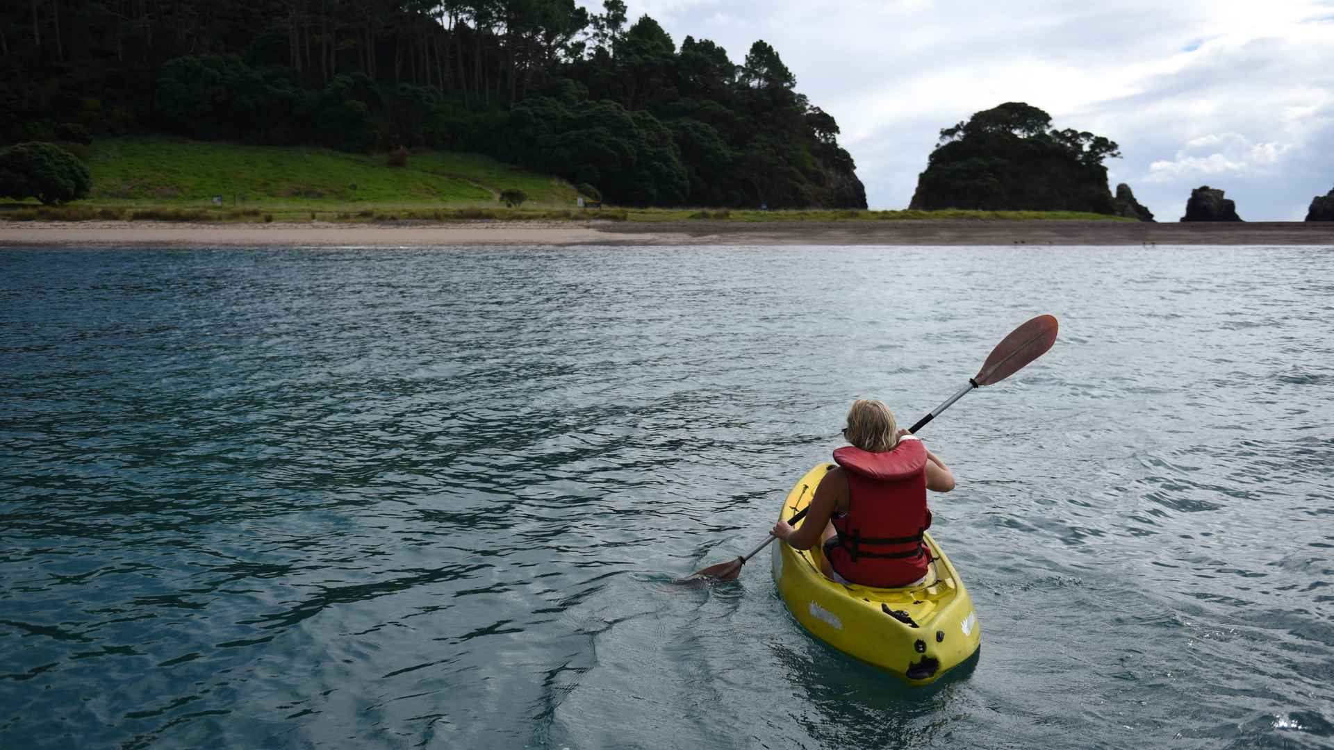 kayaking at the rock bay of islands